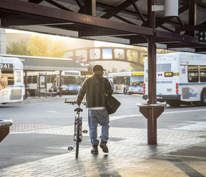 bicyclist at bus station