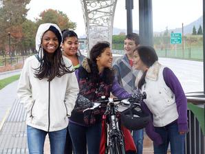 Teens with bike at EmX station
